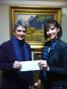 Left to right. Linda McCall Kangeter, President CCF, accepts donation check from Denise Ebbett, Co-Owner, Petrogyphe Gallery, Mokelumne Hill.