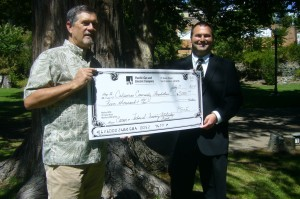 Brent Harrington, CCF Treasurer receives $5,000donation from Dylan George, Government Relations Representative, PG&E