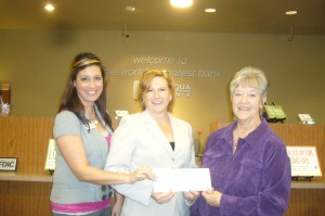 Diana Scaparro-Cammisa, San Andreas Store Manager and Christy Maynard, Angels Camp Store Manager present donation check to Chyrl Hillis, CCF BOD & Publicity Chairperson